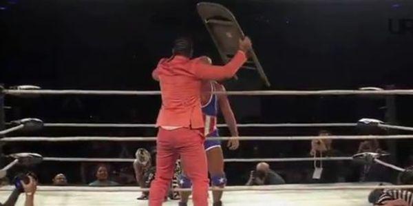 Riff Raff Interferes In A Wrestling Match Between Kurt Angle & Rey Mysterio Jr.