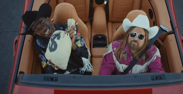 "Lil Nas X & Billy Ray Cyrus Time Travel In ""Old Town Road"" Video"
