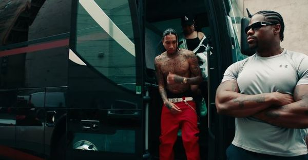 "Tyga Pays Tribute To His Former Boss In ""Lightskin Lil Wayne"" Video"