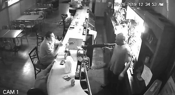 Guy Who Gives The Least Fs Ever Lights Cigarette As Bar is Robbed