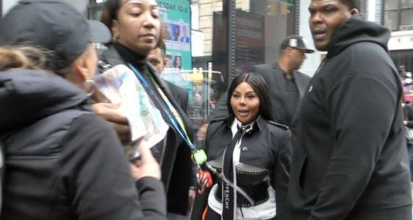 Lil Kim Almost Attacked By Animal Rights Protester