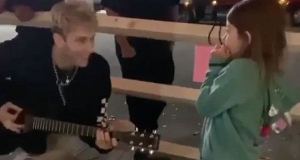 Machine Gun Kelly Plays The Guitar For A Young Girl Outside His Tour Bus [Video]