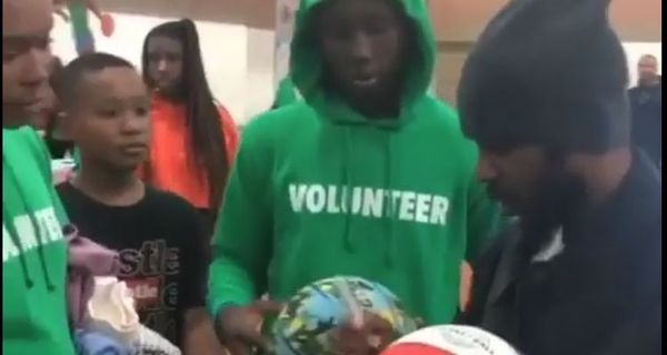 Kendrick Lamar Signs Autographs & Meets Fans At Compton Toy Giveaway