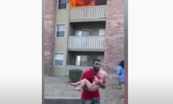 Watch an Ex-College Football Player Catch a Child Thrown from a Burning Building
