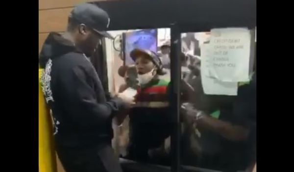 Watch 50 Cent Hand Out Money to Queens Burger King Workers